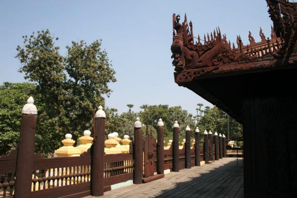 Picture of Teak Monastery in Mandalay with the typical wooden poles