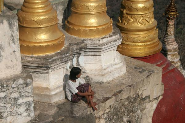 Picture of Burmese girl seeking peace on Mount Popa