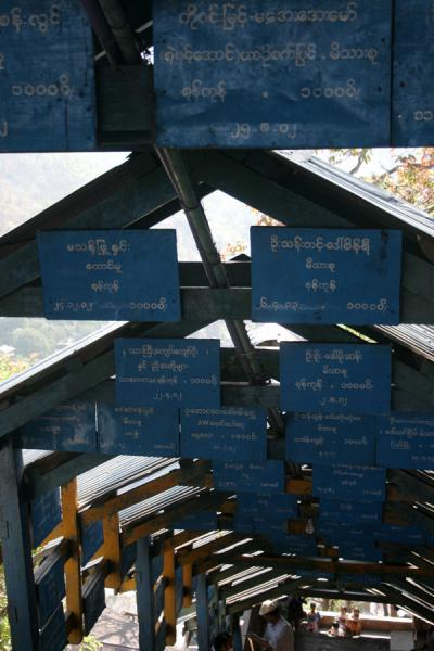 All kinds of announcements above the stairs leading up to Mount Popa | Mount Popa | Myanmar (Burma)