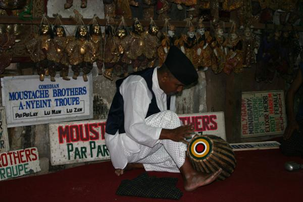 Picture of Moustache Brothers (Myanmar (Burma)): Moustache Brother Par Par Lay giving some rhythm to the show