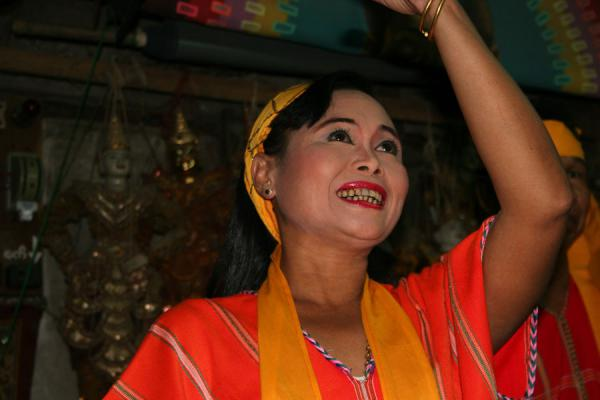 Picture of Ni Ni Lin, wife of Moustache Brother Lu Maw, in another traditional dance