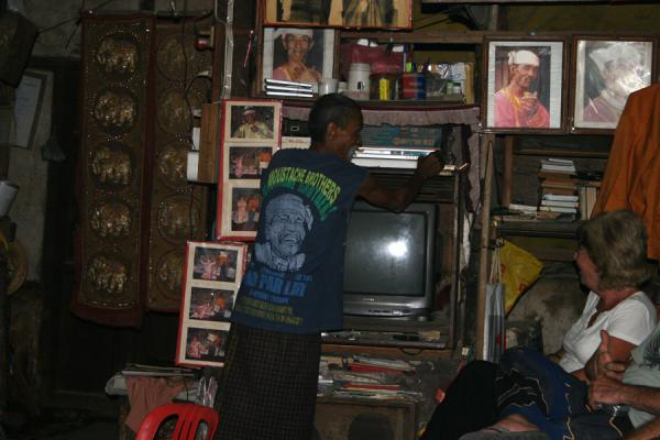 Lu Maw getting the TV ready to show a fragment of a movie in which Hugh Grant mentions his brother | Moustache Brothers | Myanmar (Burma)