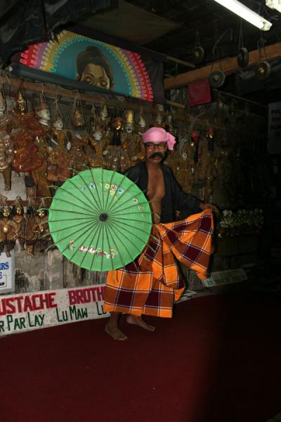 Lu Zaw performing with fake moustache and parasol | Moustache Brothers | Myanmar (Burma)