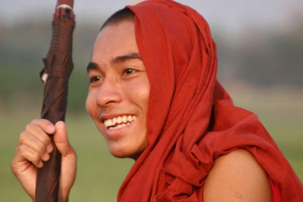 Picture of Myanmar monks (Myanmar (Burma)): Smiling Burmese monk on U Bein bridge in Amarapura