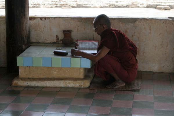 Picture of Myanmar monks (Myanmar (Burma)): Burmese monk praying in temple in Bagan