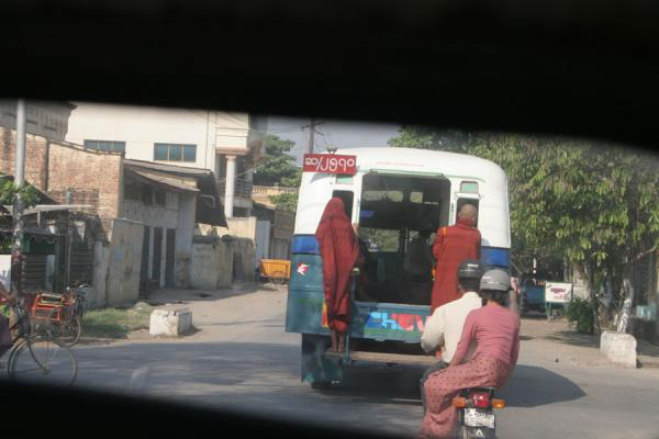 Burmese monks hanging outside a local bus | Myanmar monks | Myanmar (Burma)