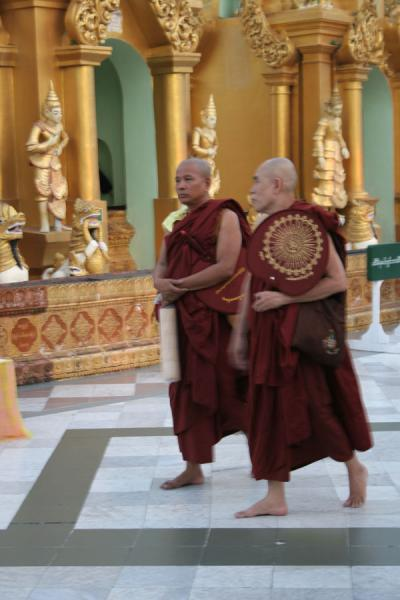 Picture of Myanmar monks (Myanmar (Burma)): Buddhist monks walking in a pagoda in Yangon