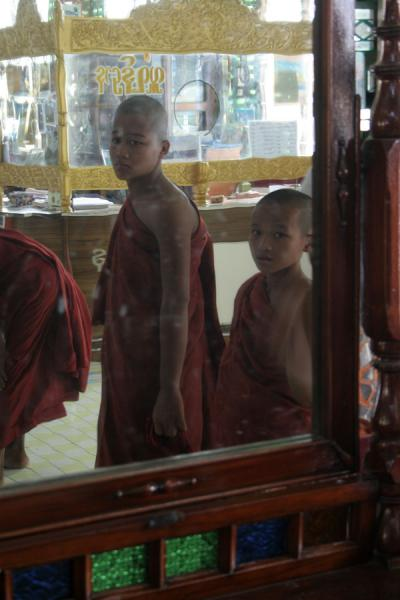 Picture of Buddhist monks reflected in a mirror in Sagaing