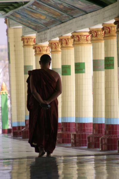 Monk walking in the corridor of a pagoda in Sagaing | Myanmar monks | Myanmar (Burma)