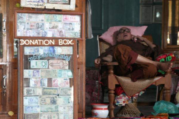 Picture of Myanmar monks (Myanmar (Burma)): Old buddhist monk waiting for donations in Jumping Cat Monastery