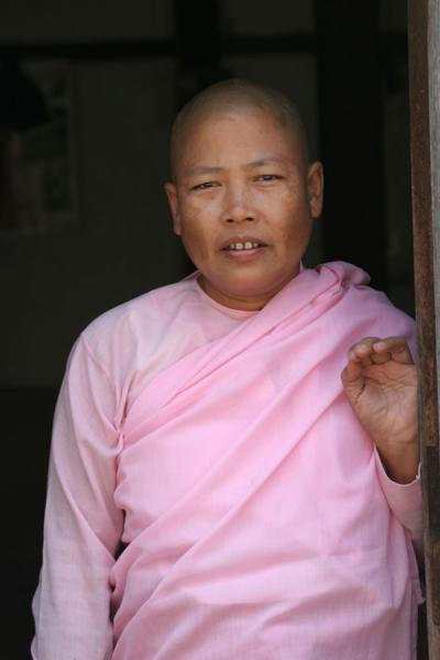 Picture of Burmese nun posing in a doorpostMyanmar (Burma) - Myanmar (Burma)