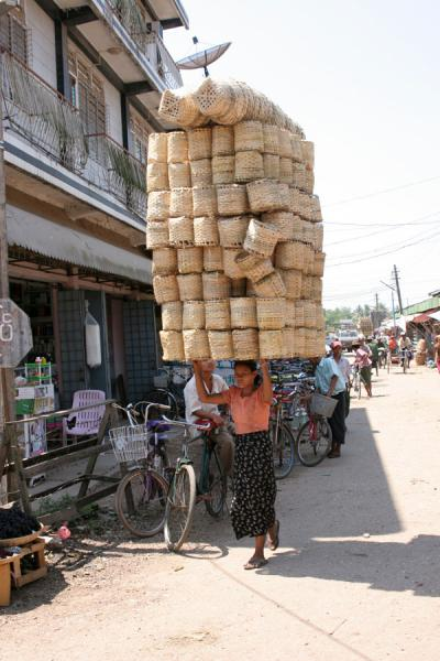 Picture of Pathein (Myanmar (Burma)): Woman carrying an amazing load in the streets of Pathein