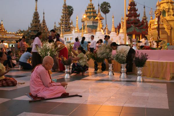 At the base of the main stupa, many people gather to pray | Shwedagon Pagoda | Myanmar (Burma)