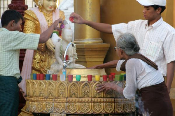 Picture of Shwedagon Pagoda: buddhists engaged in religious rituals
