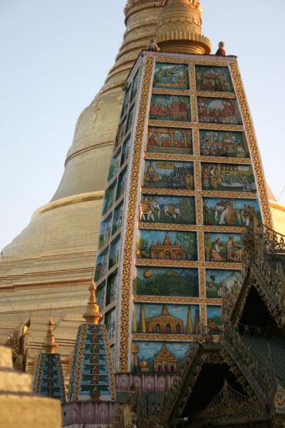 A smaller stupa with illustrations at Shwedagon Pagoda | Shwedagon Pagoda | Myanmar (Burma)