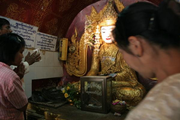 Picture of Snake Pagoda (Paleik) (Myanmar (Burma)): Praying people at the Buddha statue at the Snake Pagoda