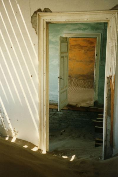 Here you can see a room through a door, another room behind it, and sun coming through ... the ceiling | Kolmanskop | Namibia