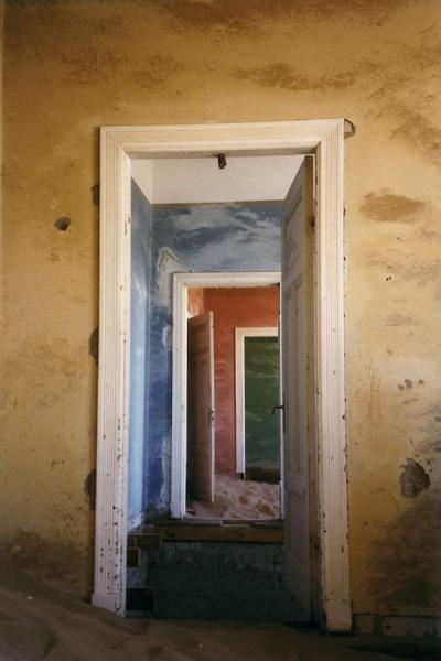 Picture of Kolmanskop (Namibia): Inside one of the houses of Kolmanskop: doors and colourful walls