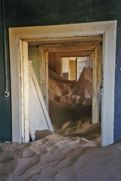 Picture of Kolmanskop (Namibia): Sand and doors inside a house of Kolmanskop
