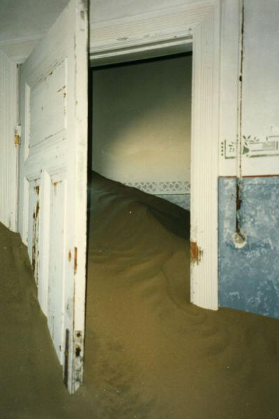 Picture of Kolmanskop (Namibia): Door with sand in one of the houses of Kolmanskop