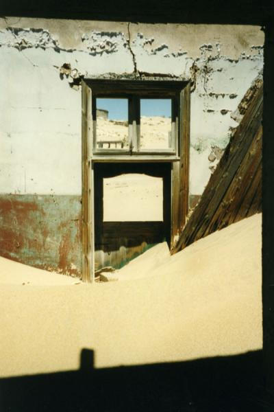 Picture of Kolmanskop (Namibia): Desert sand hiding a old door in an abandoned house of Kolmanskop