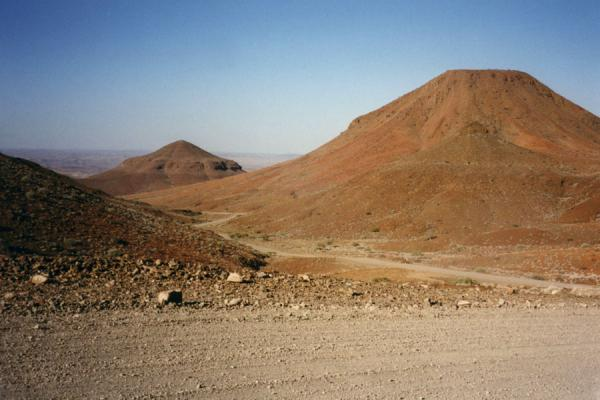 Gravel road through desolate landscape of Namibia | Namibian roads | Namibia