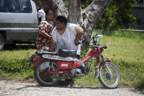 Two friends getting ready to leave on a motorbike | Gente de Nauru | Nauru