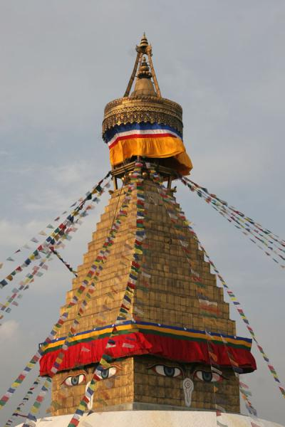 Picture of Boudha Stupa (Nepal): Typical eyes, golden tower, orange canopy and spire on the Boudha stupa