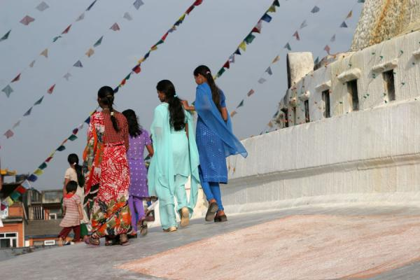 Picture of Boudha Stupa (Nepal): Colourfully dressed women walking on Boudha stupa