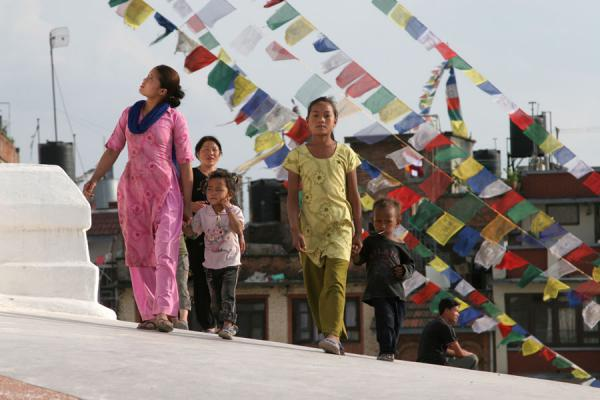 Picture of Boudha Stupa (Nepal): Woman and children walking on Boudha stupa