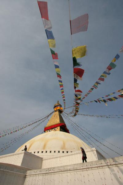 Picture of Boudha Stupa (Nepal): Prayer flags and people on Boudha stupa