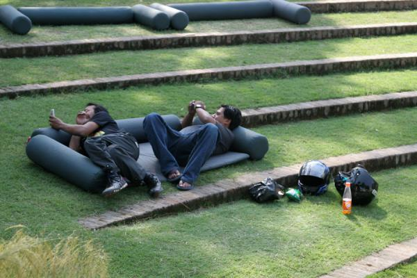 Nepali guys playing with their mobile phones in the relaxation area of the Garden of Dreams | Garden of Dreams | Nepal