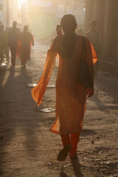 Woman walking a street of Kathmandu before sunset | Kathmandu streets | Nepal