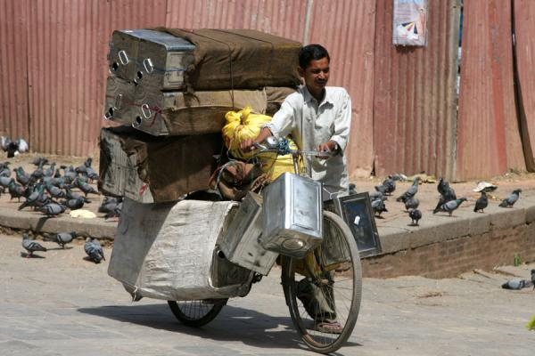 Man with a heavy load on his bicycle | Kathmandu streets | Nepal