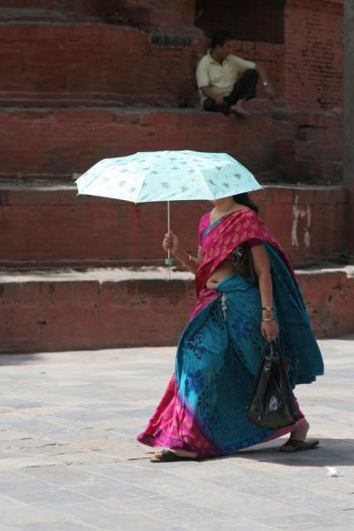 Nepali woman protected from the sun by her umbrella | Nepali people | Nepal