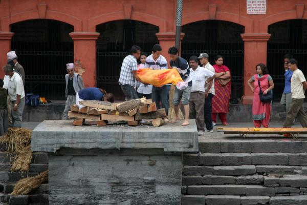 Lifting the body on a pyre on a cremation platform | Pashupatinath Crematie | Nepal
