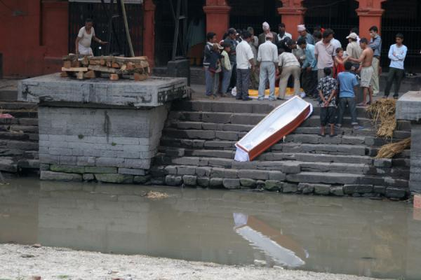 The body has been taken out of the coffin, which will be thrown into the Bagmati river | Pashupatinath Crematie | Nepal