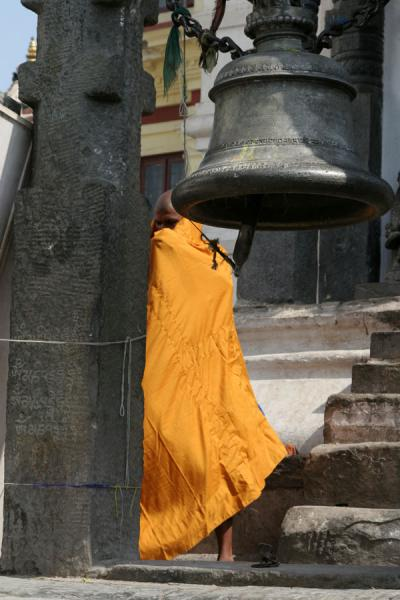 Monk and bell at Swayambhunath temple | Swayambhunath Temple | Nepal