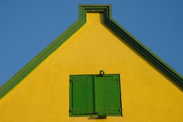 Bright colours against bright sky | Curacao windows | Netherlands Antilles