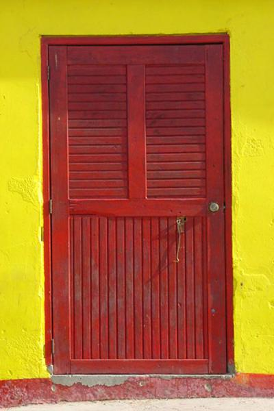 Red door in yellow house on Curacao | Curacao windows | Netherlands Antilles