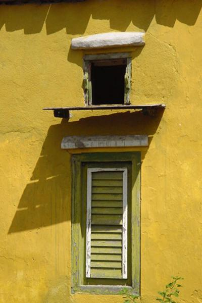 Narrow green window in a green house on Curacao | Curacao windows | Netherlands Antilles