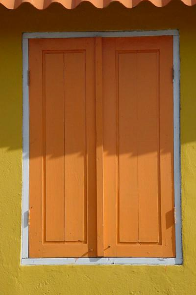 Orange window shutters in a house on Curacao | Curacao windows | Netherlands Antilles