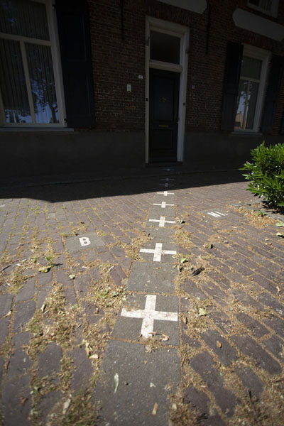 The border runs straight through the front door of this house, which also has two numbers | Baarle | Netherlands