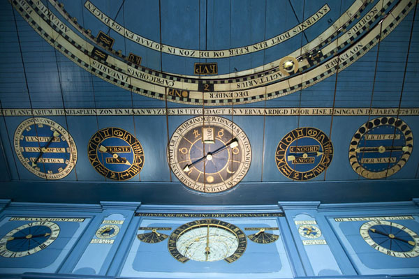 Several dials on one side of the ceiling tell the day of week, sun and moon rise and set, zodiac sign, and more | Eise Eisinga Planetarium | Netherlands