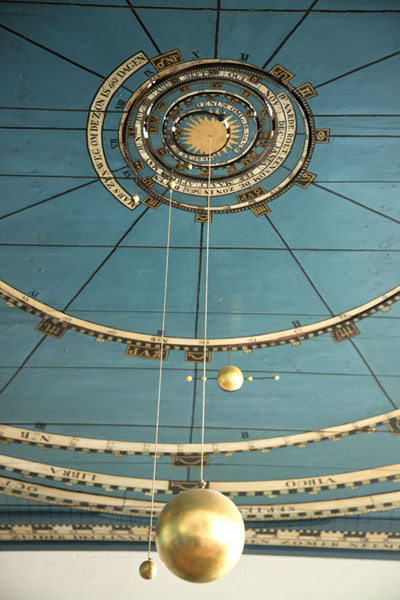 The sun and the earth hanging from the ceiling where part of the orrery can be seen | Eise Eisinga Planetarium | Netherlands