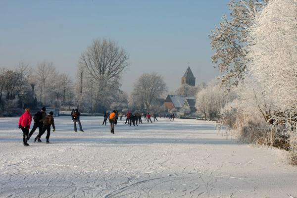Picture of Natural Ice pastime (Netherlands): Winter scene in the Alblasserwaard: skating through a town
