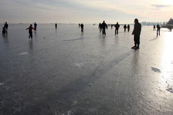 Picture of Natural Ice pastime (Netherlands): People skating, sailing and walking on the Gouwzee between Monnickendam and Marken