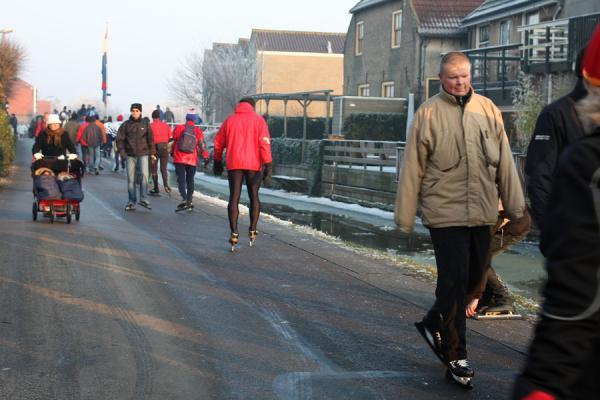 Picture of Natural Ice pastime (Netherlands): Skaters walking on skates, or klunen, to cover a short distance where skating is not possible