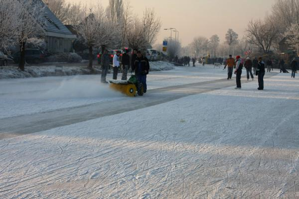 Picture of Natural Ice pastime (Netherlands): Cleaning the ice in a village in the Alblasserwaard
