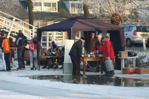 Picture of Natural Ice pastime (Netherlands): Koek and zopie: skaters get a drink and something to eat